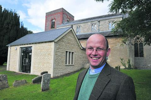 Rev Jeremy Goulston alongside the new church extension
