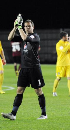 Ryan Clarke applauds the fans after United's win ove