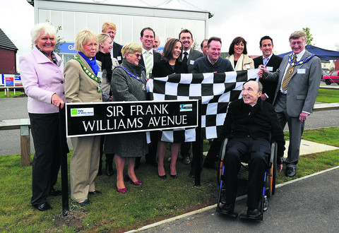 Sir Frank, right front, at the ceremony where his daughter Claire, centre, and Duncan Sabiston, fourth from right, removed a chequered flag to unveil the first of the new road signs