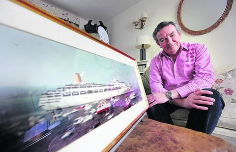 Martin Reed with a picture of the SS Canberra