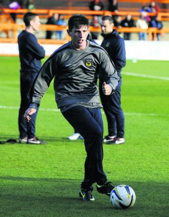 James Roberts warms up before Oxford United's clash with Barnet