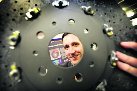 Andy Bennett with a fibre reinforced brake disc made with the same material developed for a space vehicle heat shield to prevent brakes overheating