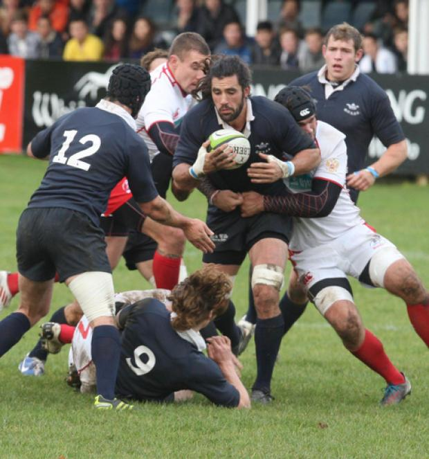 Oxford University captain John Carter keeps the ball alive during their 29-15 defeat against Russia at Iffley Road on Sunday