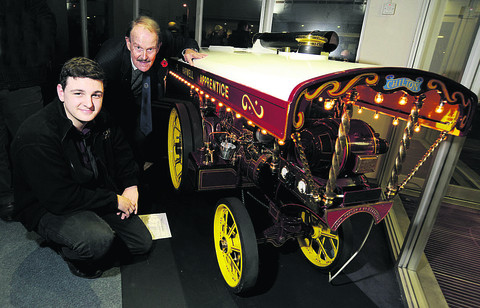 Joe Voller, 19, in the third year of his apprenticeship, meets up with 80-year-old Tony Temple, who was part of Harwell's 1948 intake. Pictured with them is a model traction engine apprentices made in the 1980s