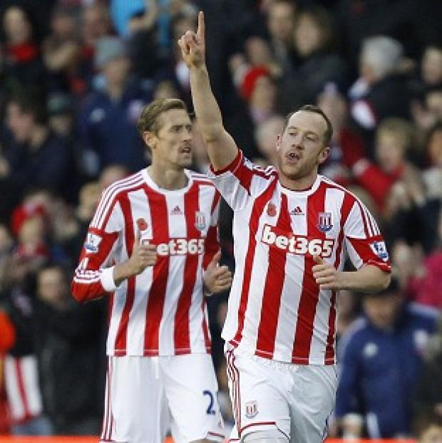 Herald Series: Charlie Adam, right, put Stoke ahead against Queens Park Rangers