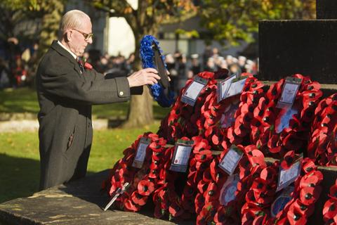 Peter Leach lays wreath at the remembrance service in St. Giles.