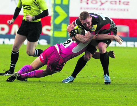 London Welsh's Lee Beach is stopped in his tracks