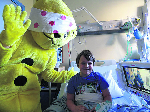 Pudsey meets seven-year-old Alistair Hartshorn at the Horton Hospital