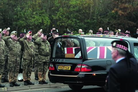 Herald Series: The hearse carrying the body of Captain Walter Barrie passes the Memorial Gardens in Carterton