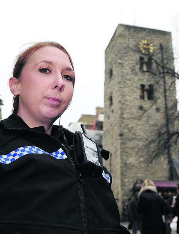 Herald Series: Pc Sarah Lally, pictured outside the tower of St Michael at the Northgate Church, where she managed to talk down a man who was threatening to jump. Picture: OX55612 Jon Lewis