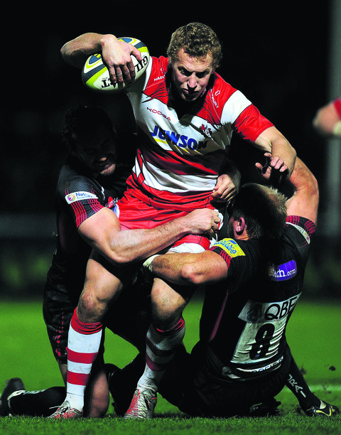 Gloucester's Billy Twelvetrees is tackled by London Welsh duo Adam Balding and Sonny Parker