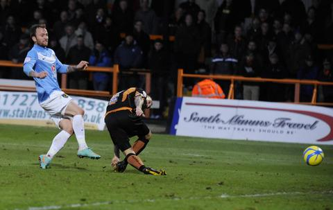 Sean Rigg, pictured scoring against Barnet in the FA Cup recently, is back for the League Two fixture