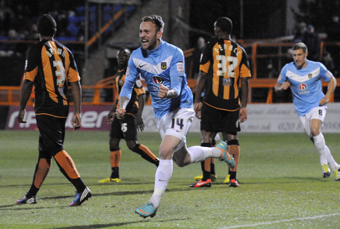 Sean Rigg shows his delight at scoring an equaliser for Oxford United just seconds after they had gone behind at Barnet last night