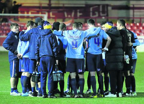 Oxford United's players and management at the final whistle at Accrington