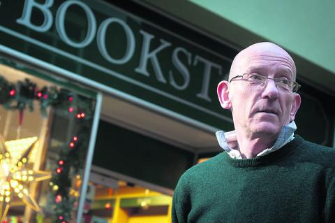 Ian Collett, owner of The Bookstore outside his shop in the precinct