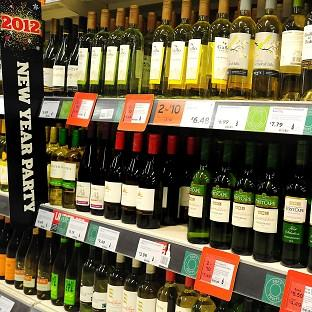 A family's Christmas booze bill would rise by around 17 pounds under plans to impose a minimum price for alcohol