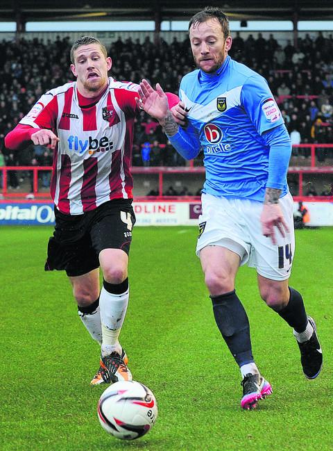 Sean Rigg, right, goes past Exeter's Scot Bennett on Wednesday   Picture: Jon Lewis