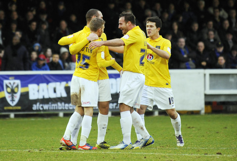 Lee Cox (right) joins the celebrations for Alfie Potter's goal