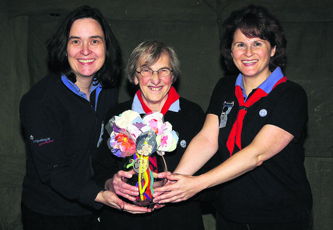 Caroline Ashby, centre, is presented with a retirement gift by fellow leaders Barbara Bellis, left, and Sally Dance