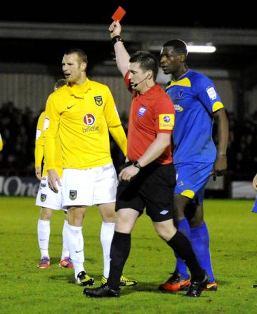 James Constable gets his marching orders from Lee Collins at AFC Wimbledon