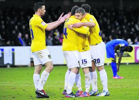 Herald Series: Alfie Potter (No 15) celebrates his header against AFC Wimbledon last Saturday  Picture: David Fleming