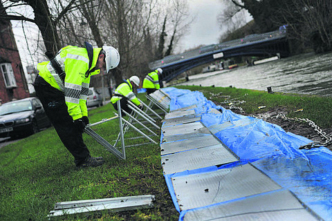 Environment Agency staff remove the flood defences in West Street and East Street, Osney Island