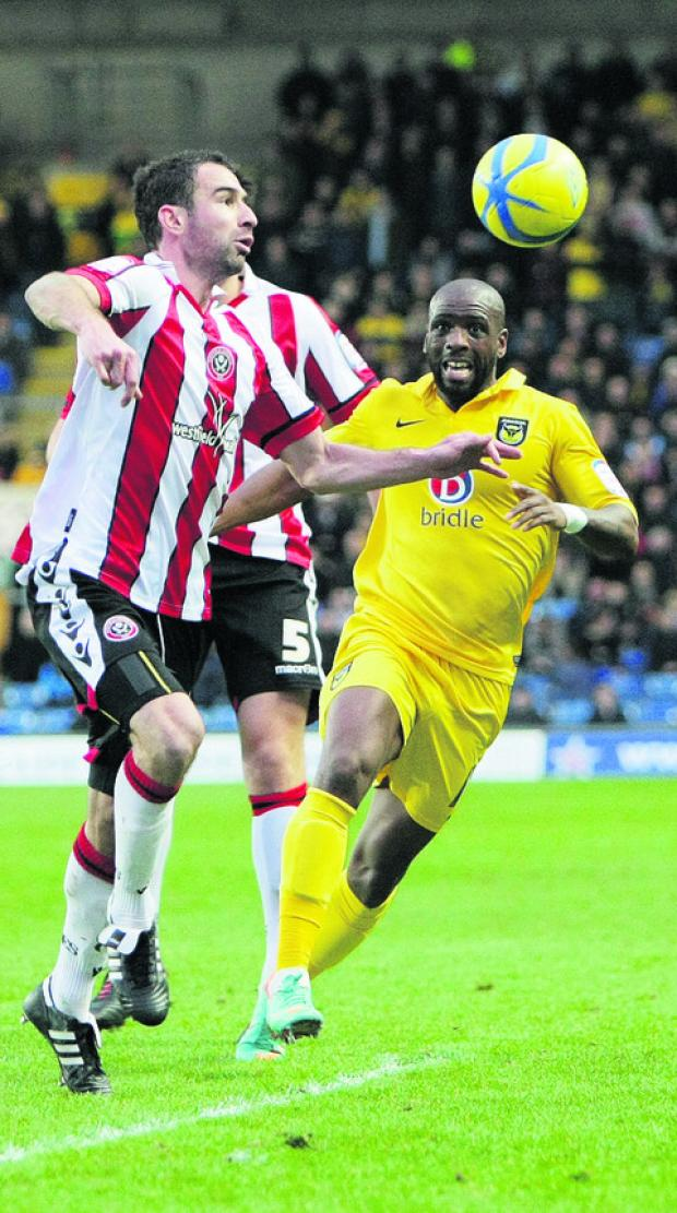 Justin Richards puts Sheffield United's Danny Higginbotham under pressure at the Kassam Stadium last week