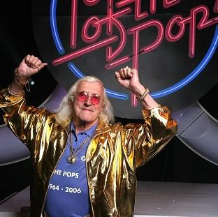 Jimmy Savile on the set during the filming of the final Top Of The Pops. (Mark Allan/BBC/PA)