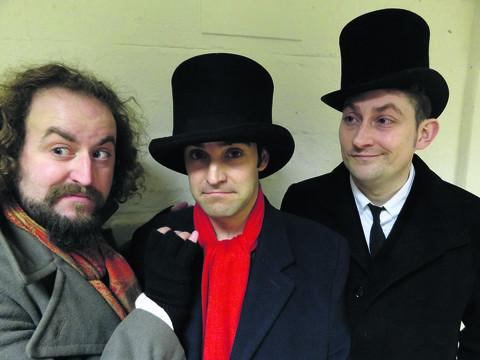 Terry Pratchett's Dodger is being shown at Abingdon Unicorn Theatre. Solomon, Matt Kirk, left, and Dickens, Dan Bond, right, help Dodger, Jamie Crowther, to look more like a gent