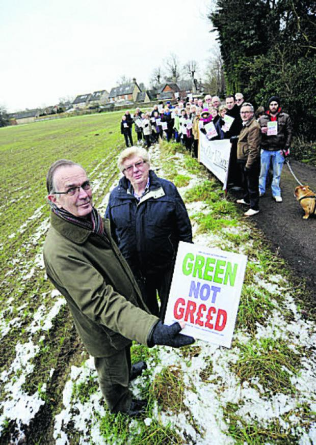 David Warr, a member of Kingston Bagpuize with Southmoor Village Action – pictured front left with other protesters