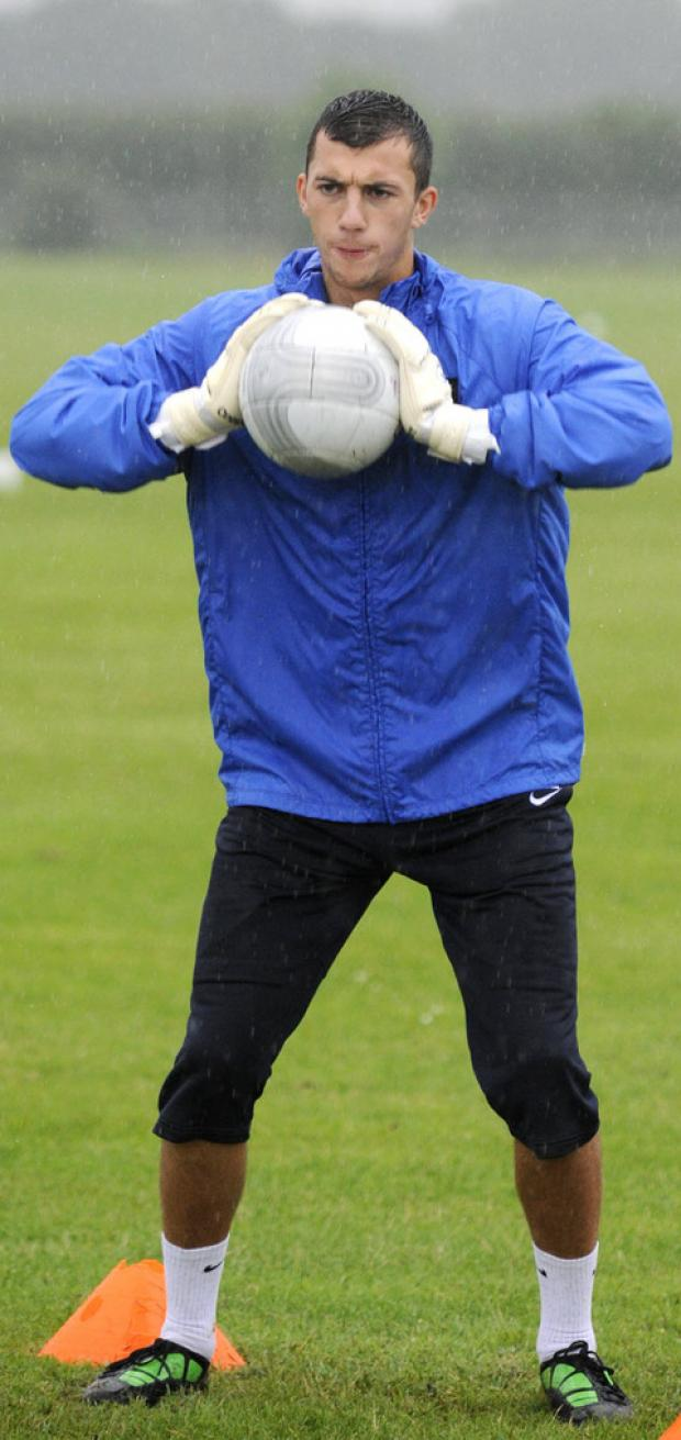 Oxford United's keeper Max Crocombe in action during training