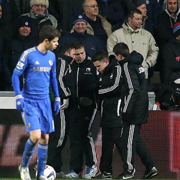 A ball boy (second right) is ushered away following an incident with Chelsea footballer Eden Hazard at the Liberty Stadium, Swansea