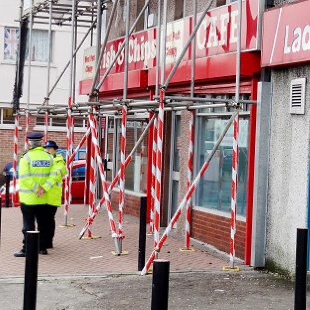 Police at the scene of an attempted armed robbery at the Ladbrokes branch on Crownhill Road in Plymouth