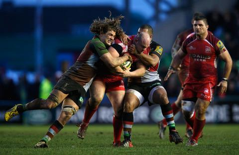 London Welsh replacement Billy Moss is grabbed by two Harlequins men late in the game