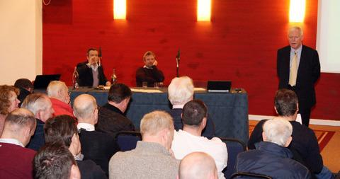 Oxford United chairman Ian Lenagan (right) addresses the fans with directors Adrian Lenagan (left) and Simon Lenagan in the background