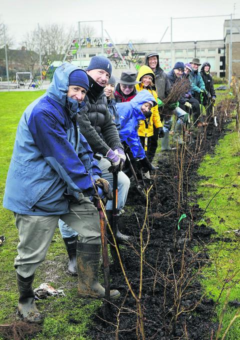 Volunteers help create a forest school garden at Caldecott Primary School, including, from left, Cliff Marshall, from the Abingdon Carbon Cutters, and James Corbett, vice-chairman of the school governors. Picture: OX57180 David Fleming