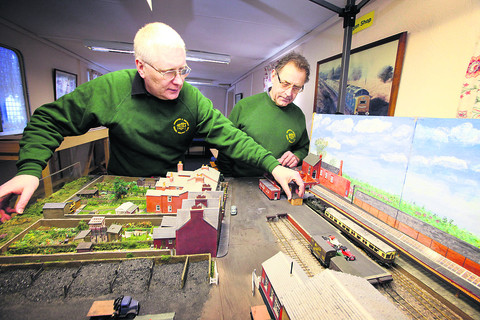 Tom Wellman, left, and Ivan Cadge working on a model of the Abingdon branch line. Picture: OX57434 Damian Halliwell