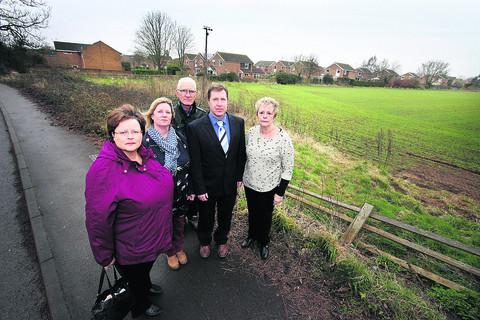 Herald Series: Alison Rooke, Rebecca Evans, Pat Lonergan, Russell Clear and Janet Walker by the site for a proposed 60-home development. Picture: OX57588 Damian Halliwell