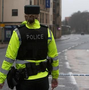 Weapons have been discovered by police searching a house in Hawthorn Street, west Belfast