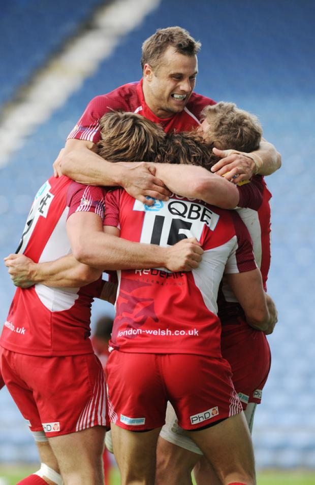 LOndon Welsh players led by Tyson Keats (centre) celebrate Tom Arscott's try against Saracens at the Kassam Stadium in October. Will they have anything to cheer tomorrow?