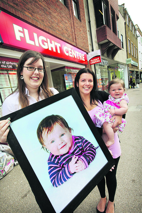 Flight Centre personal travel manager Kayleigh Cox, left, with winner Isabella Charlett and mum Daisy Fleetwood