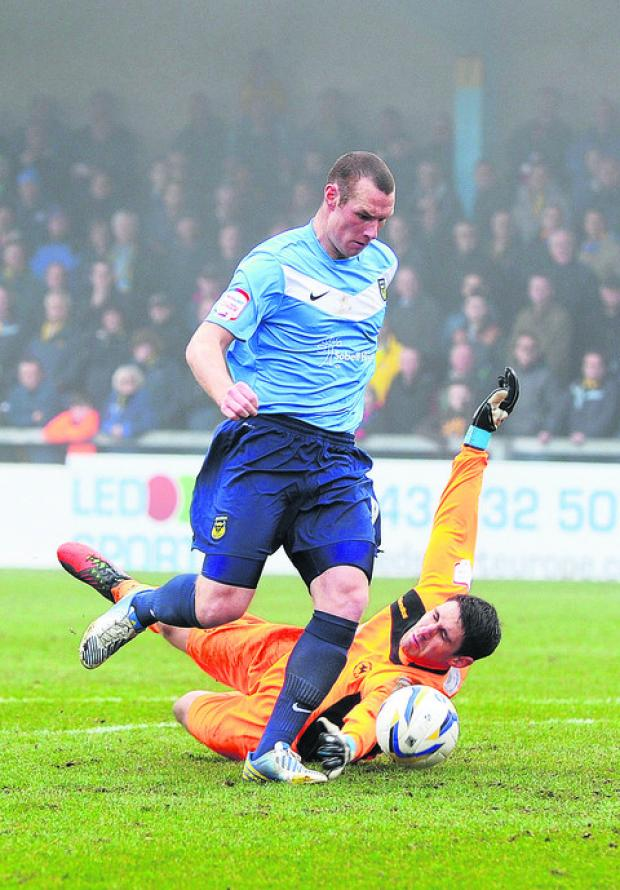 James Constable rounds Torquay keeper Michael Poke before slotting home to put Oxford ahead