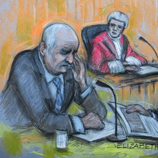 Artist's drawing of Mick Philpott in the witness box at Nottingham Crown Court (PA)