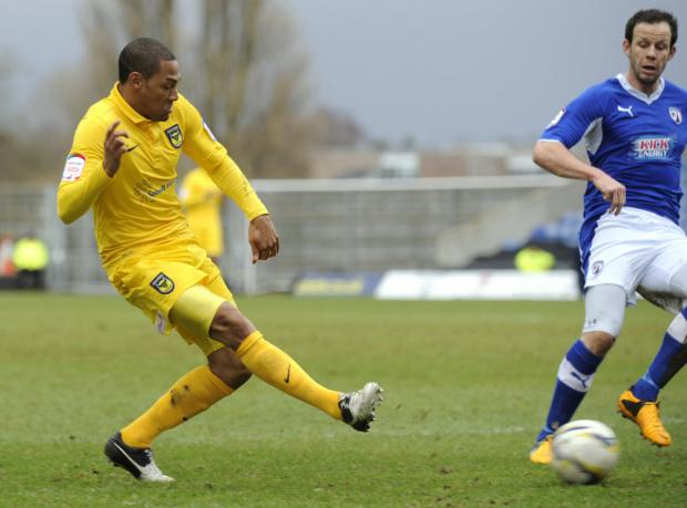 Damian Batt sends in a cross against Chesterfield on Saturday