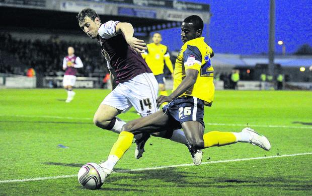Liam Davis sends in a cross on his return to Northampton last season