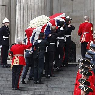 Herald Series: The coffin of Baroness Thatcher is carried aloft by members of the armed forces and into St Paul's Cathedral