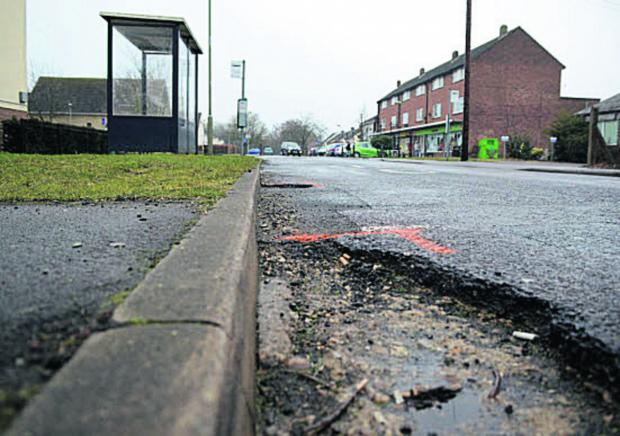 AFTER REPAIRS: Fixed but cracks have emerged further along the road outside Berinsfield Co-op, Wallingford