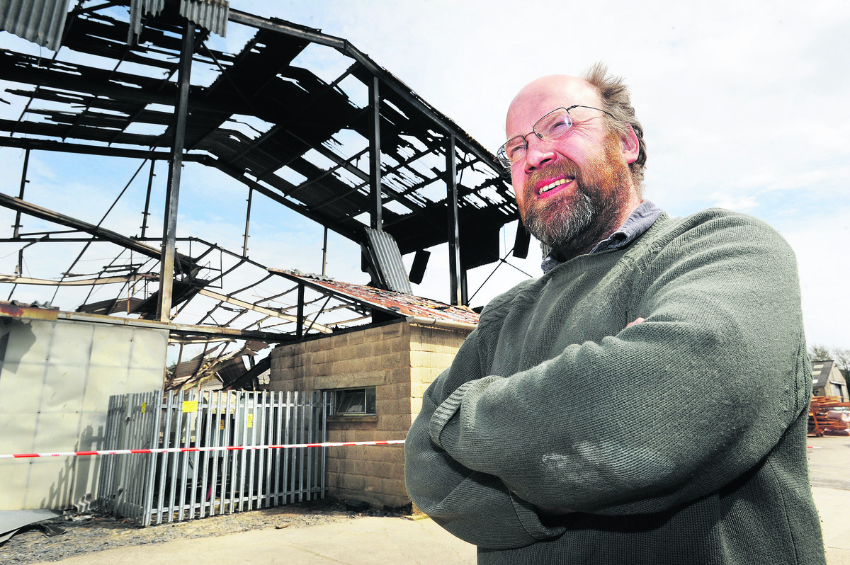 Vincent Schofield of Rectory Stone outside the damaged building; inset, the burnt-out car mechanic's workshop