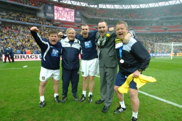 Herald Series: Chris Wilder celebrates winning promotion at Wembley with his backroom team and chairman Kelvin Thomas