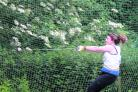 Radley's Emma Hara almost throws herself off her feet as she hurls the winning hammer throw at Tilsley Park